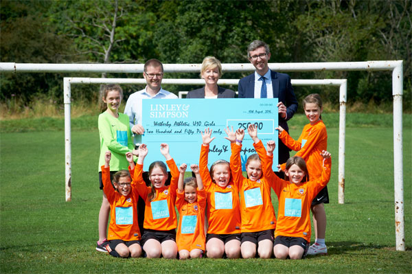 Linley & Simpson helps Wetherby girl's soccer team, Collingham Cricket & Long Marston Cricket Club 'net' grass roots community cash