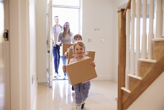 Photo of a family entering a house